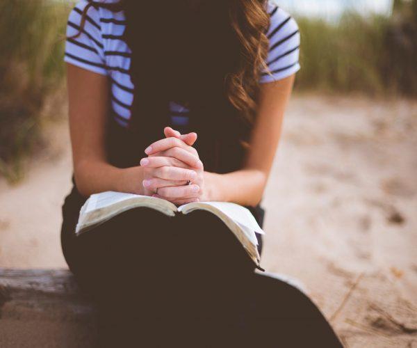 girl seated praying